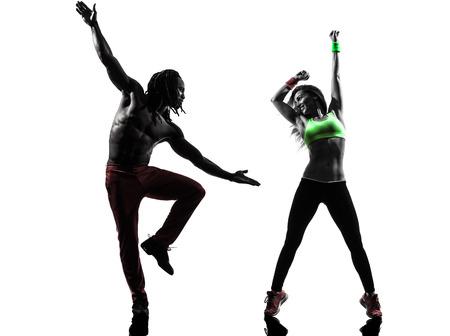 shadows: pareja hombre y mujer en el ejercicio Zumba Fitness bailando en silueta sobre fondo blanco