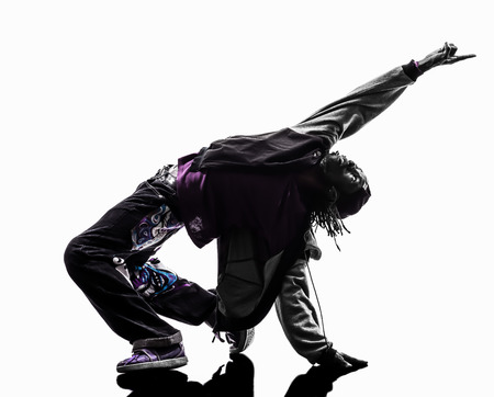 hip hop dancing: one hip hop acrobatic break dancer breakdancing young man silhouette white