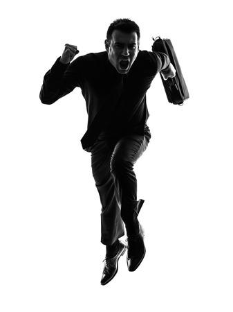hombres corriendo: un hombre de negocios cauc�sico que se ejecuta en silueta sobre fondo blanco