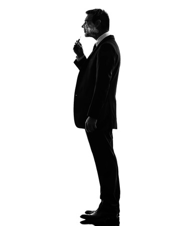 man smoking: one caucasian business man smoking electronic e-cigarette  in silhouette  on white background Stock Photo