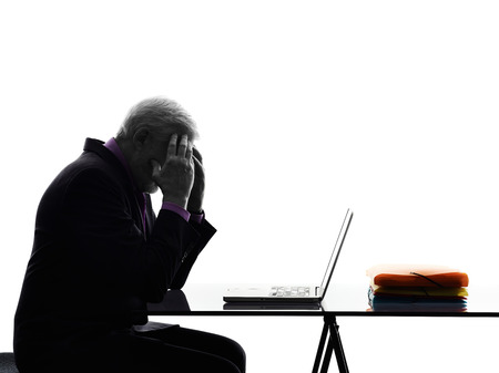 One Caucasian Senior Business Man computing laptop tired headache Silhouette White Background photo