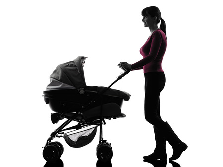 one caucasian woman prams baby walking silhouette on white background photo