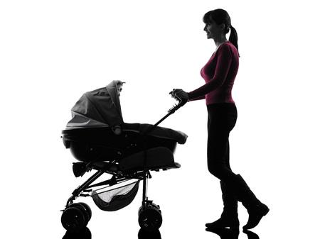 one caucasian woman prams baby walking silhouette on white background Stock Photo - 24195141