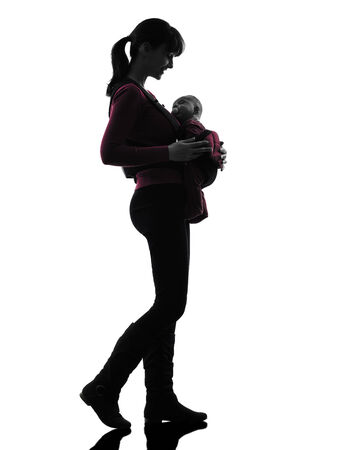 one caucasian woman mother walking baby silhouette on white background photo