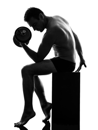 one caucasian man exercising body building in silhouette on white background photo