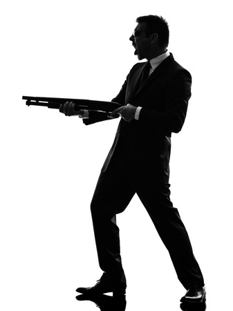 one caucasian killer man in silhouette  on white background photo