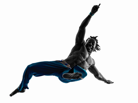 one man capoeira dancer dancing silhouette studio isolated on white background Stock Photo