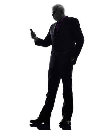 senior business man: One Caucasian Senior Business Man on the telephone angry Silhouette White Background