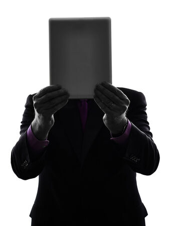 One Caucasian Senior Business Man holding digital tablet Silhouette White Background photo