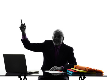 man pointing up: One Caucasian Senior Business Man Pointing Up Silhouette White Background Stock Photo