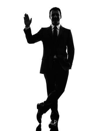 one caucasian business man saluting  in silhouette  on white background 版權商用圖片