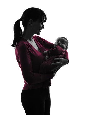 one caucasian woman holding baby silhouette on white background photo