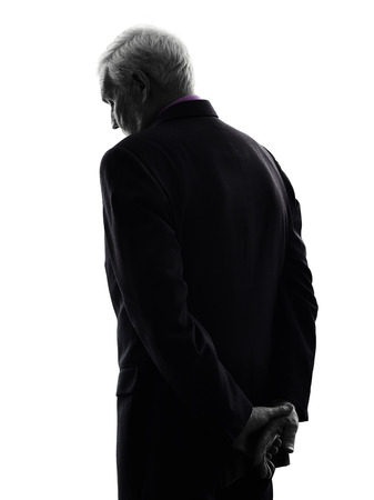 man rear view: One Caucasian senior business man sad rear view silhouette White Background
