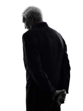 shadows: Un hombre de negocios de alto de raza cauc�sica de visi�n trasera triste silueta Fondo Blanco Foto de archivo