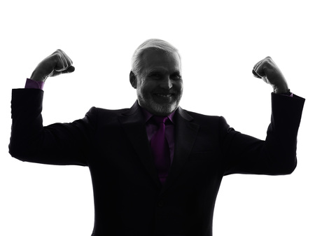 senior business man: One Caucasian senior business man flexing muscles strong silhouette White Background