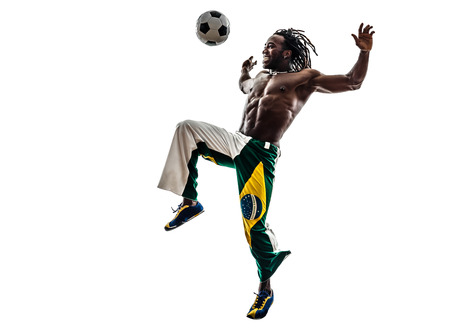 one brazilian black man soccer player juggling football on white background photo