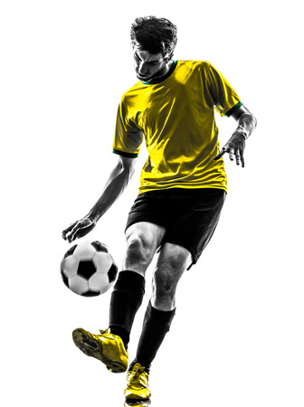 cut the competition: one brazilian soccer football player young man in silhouette studio on white background