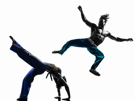two people couple capoeira dancers dancing in silhouette studio isolated on white background Stock Photo - 25069834