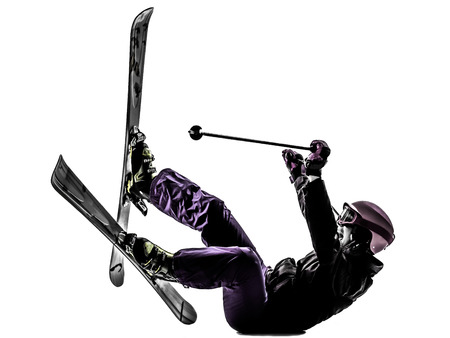 skiing accident: one caucasian woman skier skiing falling in silhouette on white background