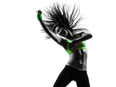 dancing woman: one caucasian woman exercising fitness zumba dancing in silhouette on white background