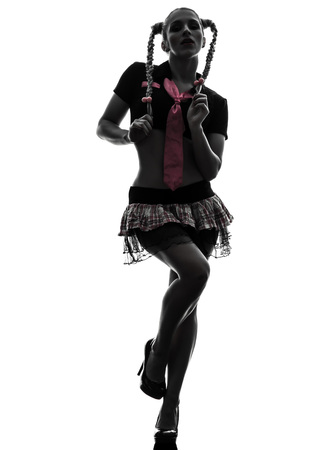one caucasian sexy woman schoolgirl costume portrait in silhouette studio isolated on white background photo