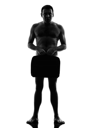 naked silhouette: one caucasian business business man naked with briefcase in silhouette  on white background