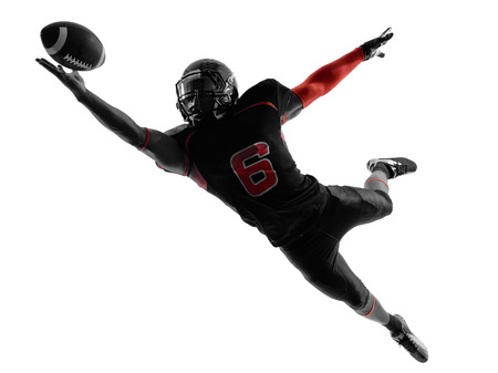 american football background: one american football player catching ball  in silhouette shadow on white background Stock Photo