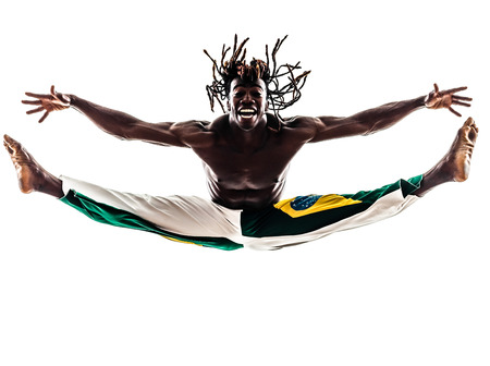 one brazilian black man dancer dancing capoeira  photo