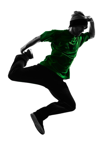 one caucasian young acrobatic break dancer breakdancing man in silhouette