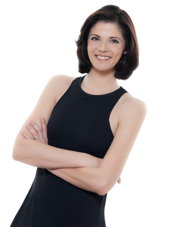 classic woman: one beautiful smiling caucasian woman portrait arms crossed in studio  Stock Photo