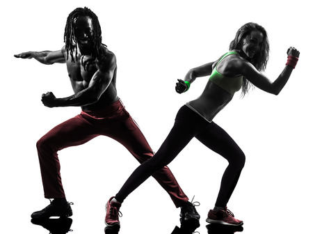 couple man and woman exercising fitness zumba dancing in silhouette