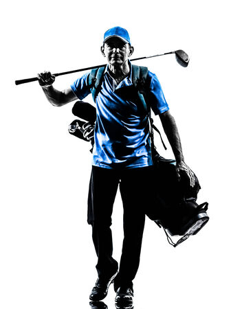 one man: one man golfer golfing golf bag walking in silhouette studio isolated on white background