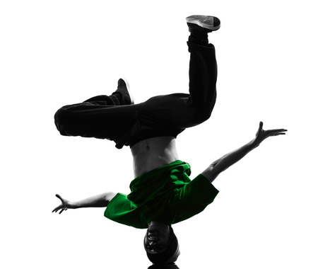 one caucasian young acrobatic break dancer breakdancing man in silhouette  white background photo