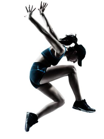 caucasico: una mujer de raza cauc�sica corredor corredor de salto en el estudio de la silueta sobre fondo blanco