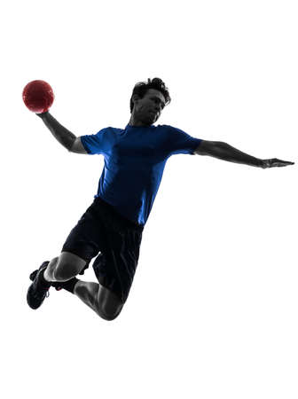handball: one caucasian young man exercising handball player in silhouette studio on white background
