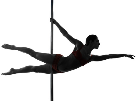 pole dancing: one caucasian woman pole dancer dancing in silhouette studio isolated on white background