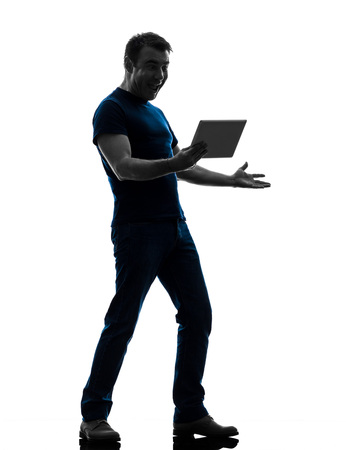 one caucasian man holding watching digital tablet  in silhouette on white background photo