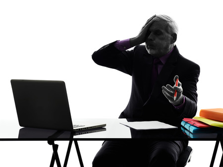 One Caucasian Senior Business Man computing laptop displeased Silhouette White Background photo