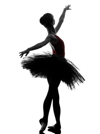 one caucasian young woman ballerina ballet dancer dancing with tutu in silhouette studio on white background