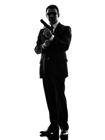 gun shot: one secret service security bodyguard agent  man in silhouette  on white background