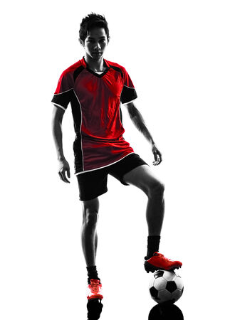one asian soccer player young man standing  in silhouette isolated white background photo
