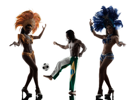 brazilian women samba dancer and soccer player man dancing silhouette on white background photo