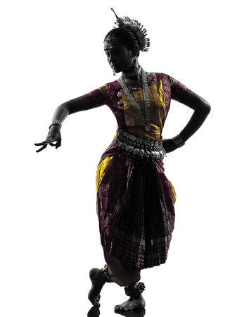 one indian woman dancer dancing in silhouette studio isolated on white background Stock fotó
