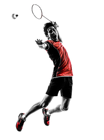 badminton: one asian badminton player young man  in silhouette isolated white background Stock Photo