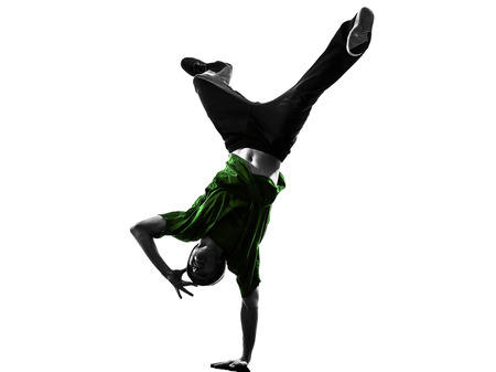 hip: one caucasian young acrobatic break dancer breakdancing man in silhouette  white background