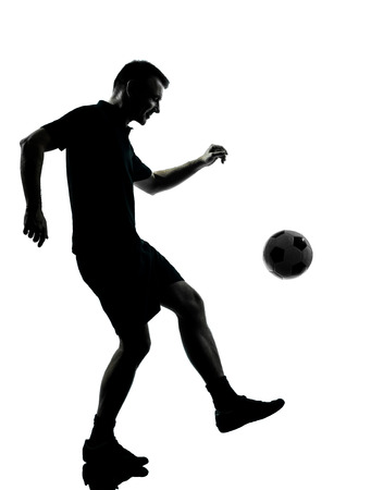 one man: one man soccer player in studio silhouette isolated on white background