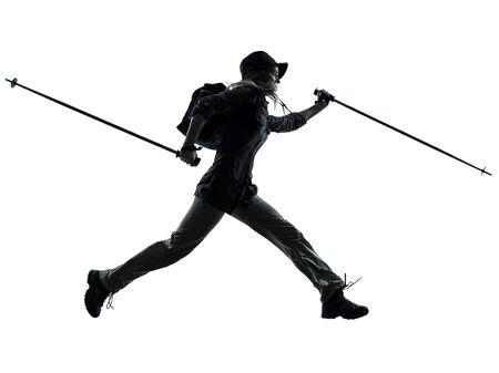 one caucasian woman trekker trekking running in silhouette studio isolated on white background photo