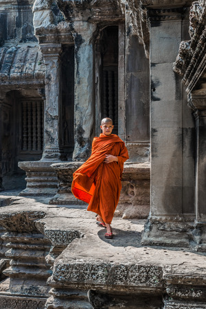 Angkor, Cambodia - January 1, 2014: buddhist monk walking in angkor wat temple cambodia on january 1st, 2014