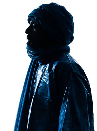 one Tuareg Portrait in silhouette studio isolated on white background
