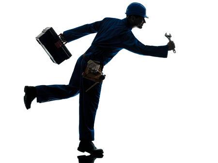 one caucasian repairman worker running urgency silhouette in studio on white background photo